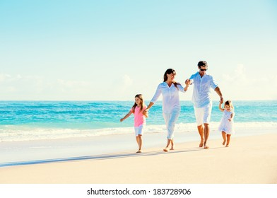 Happy Family Having Fun on Beautiful Sunny Beach