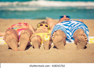 Happy family having fun on the beach. Summer vacation and travel concept