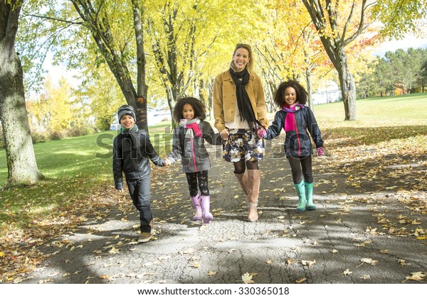 A Happy family having fun on beautiful autumn day