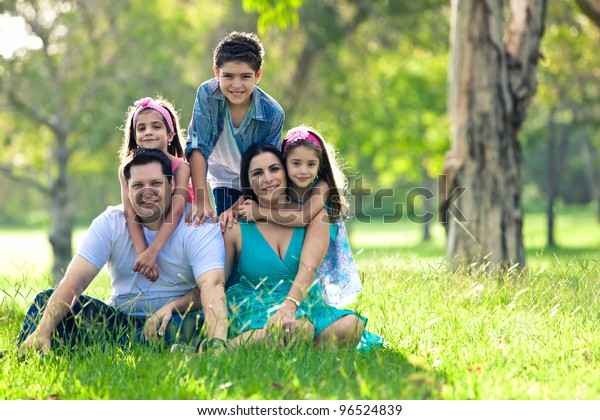 Happy family having fun outdoors in spring green park