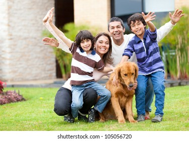 Happy family having fun outside their house