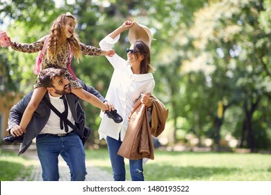 happy family having fun in park after school