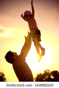 A happy family having fun, sunset, park, outdoor