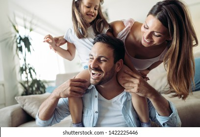 Happy family having fun time at home - Shutterstock ID 1422225446