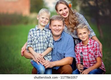 Happy family having fun together. Autumn portrait.