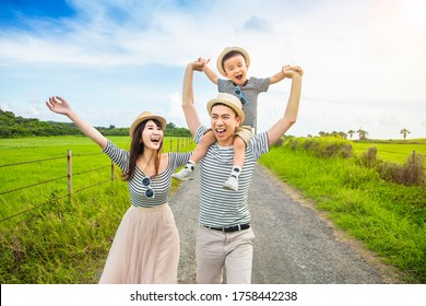 happy family having fun and walking on the country road