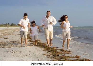 Happy family having good time on a beach.