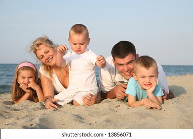 happy family having holiday at the beach