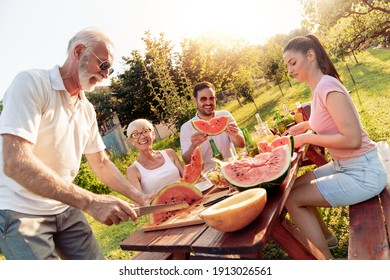 Happy family having lunch at summer garden party.People,food,love and happiness concept.