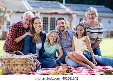 Happy family having a picnic in the garden
