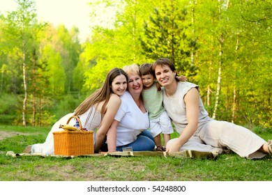 happy family having picnic in the nature