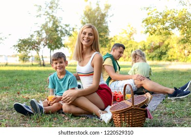 Happy family having picnic in park on sunny day
