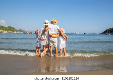 happy family having a rest on the sandy beach of a sea resort