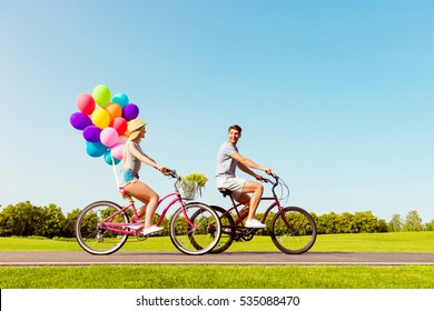 Happy family having summer weekend and riding bicycles.