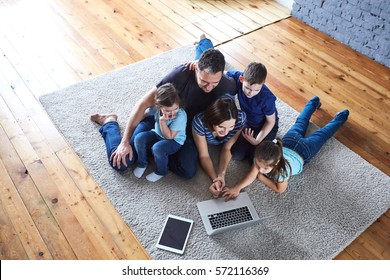 happy family at home looking at laptop. Happy large family
