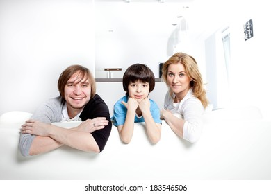 happy family in the interior of a new home