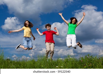 Happy family jumping outdoor