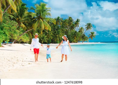 happy family with kid playing on beach