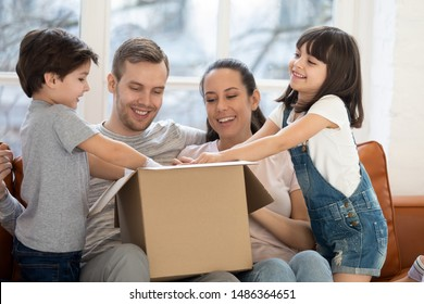 Happy family with kids customers renters open cardboard box receive parcel unpack after relocation, cute children helping parents unbox package at home, post shipping delivery and moving day concept