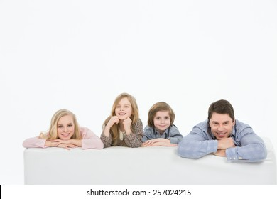 A happy family with kids on the couch white background