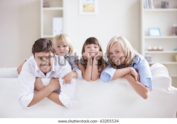 A happy family with kids on the couch