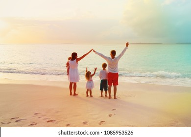 happy family with kids play, have fun at sunset, parenting