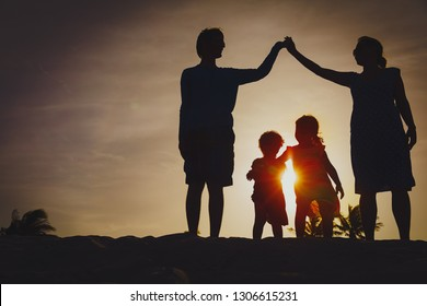 Happy family with kids play together at sunset