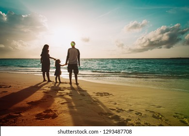 happy family with kids walk on sunset beach