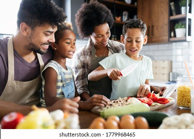 Happy family in the kitchen having fun and cooking together. Healthy food at home. - Shutterstock ID 1779968465