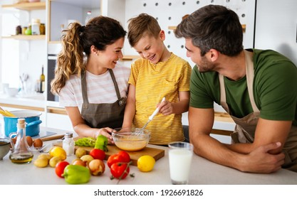 Happy family in the kitchen having fun and cooking together.