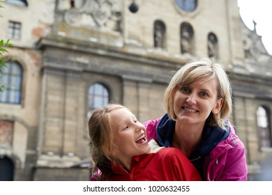 Happy family laughing in downtown old city Europe