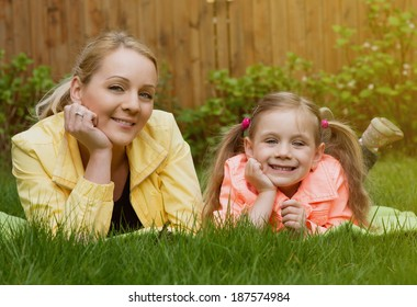 happy family laying at grass outdoor