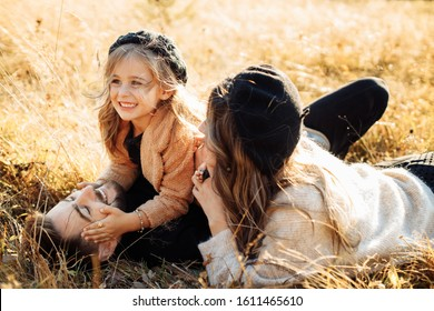 Happy family lies on the grass in the mountains