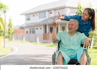 Happy family lifestyle concept. retirement  asian man Stay in front of home with granddaughter point to. Senior man 80 years has alzheimer's disease. Memory problem due to Dementia with a brain scared