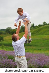 happy family with little son in lavender field, enjoy nature and relaxation