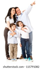 Happy family looking away and pointing - isolated over white