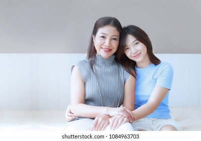 Happy family and Lovely Beautiful Mom And teenage daughter spend time together at home , mother's day