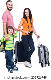 Happy family with luggage are ready to travel. Isolated on white background.