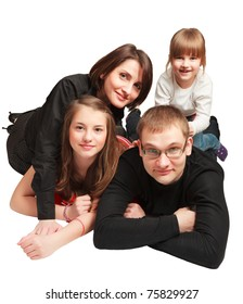Happy family lying down over white background