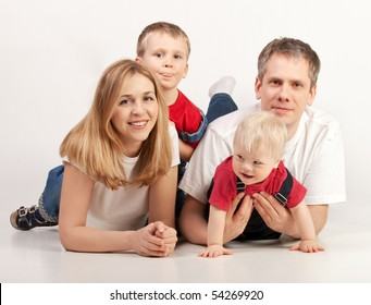 Happy family lying in the floor