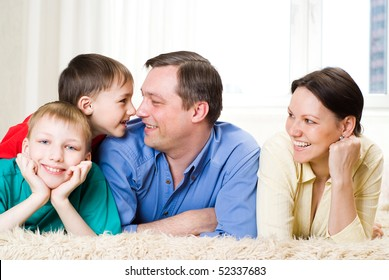 happy family  lying on the carpet