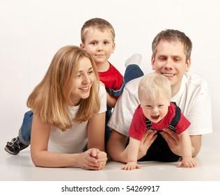 Happy family lying on White Background