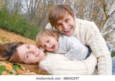 happy family lying and smiling in autumn