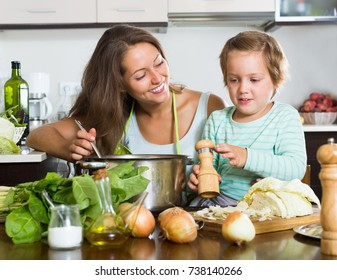 Happy family make soup  at home kitchen
