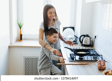 Happy family making breakfast in the kitchen