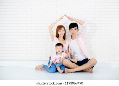 happy family  making new house with roof  by hands