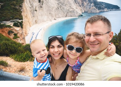 happy family making selfie with great view on beautiful beach