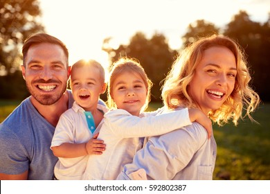 Happy family with male and female children