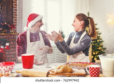 happy family married couple baking christmas cookies and laughing