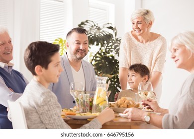 Happy family meeting for a celebration dinner